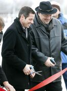 Mayor Brian Bowman, left, and councillor Russ Wyatt  cut the ribbon to officially open Transcona Boulevard.