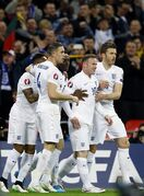 England's scorer Wayne Rooney, second right, and his teammates celebrate their side's first goal during the Euro 2016 Group E qualifying soccer match between England and Lithuania at Wembley Stadium in London, Friday, March 27, 2015. (AP Photo/Kirsty Wigglesworth)