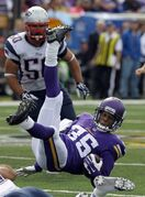 Minnesota Vikings cornerback Marcus Sherels, right, is upended as New England Patriots' Rob Ninkovich, rear, watches, after Sherels returned a punt 11 yards during the fourth quarter of an NFL football game Sunday, Sept. 14, 2014, in Minneapolis. (AP Photo/Ann Heisenfelt)