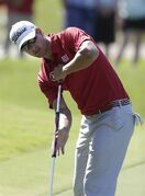 FILE - In this May 9, 2013 file photo, Adam Scott of Australia putts on the 15th green during the first round of The Players championship golf tournament at TPC Sawgrass in Ponte Vedra Beach, Fla. Golf's governing bodies have adopted a new rule that outlaws the putting stroke used by four of the last six major champions. The Royal & Ancient Golf Club and U.S. Golf Association announced Tuesday, May 21, 2013 that Rule 14-1b would start in 2016. The new rule will make it illegal to anchor the club against the body when making a golf stroke. (AP Photo/Chris O'Meara, File)