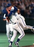 FILE - In this Oct. 27, 1985, file photo, Kansas City Royals pitcher Bret Saberhagen, right, embraces third baseman George Brett after pitching shutout to give the Royals the World Series crown over the St. Louis Cardinals in Kansas City, Mo. Saberhagen and Brett both see similarities between their '85 championship team and the group of Royals trying to replicate their feat. (AP Photo/Cliff Schiappa, File)