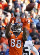 FILE- In this Dec. 28, 2014, file photo, Denver Broncos wide receiver Demaryius Thomas (88) pulls in a pass to set up a touchdown run against the Oakland Raiders during the first half of an NFL football game in Denver. Thomas said Monday, March 30, 2015, that he'll skip the Denver Broncos' offseason workouts until the sides agree on a long-term contract. (AP Photo/Jack Dempsey, File)