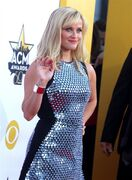 """FILE - In this April 19, 2015 file photo, Reese Witherspoon arrives at the 50th annual Academy of Country Music Awards at AT&T Stadium in Arlington, Texas. Witherspoon will narrate Harper Lee's """"Go Set a Watchman,"""" HarperCollins announced Thursday, April 23. (Photo by Jack Plunkett/Invision/AP, File)"""