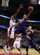 Phoenix Suns guard Gerald Green (14) shoots over Washington Wizards center Kevin Seraphin (13), from France, in the first half of an NBA basketball game, Sunday, Dec. 21, 2014, in Washington. (AP Photo/Alex Brandon)