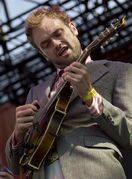FILE - In this June 9, 2012 file photo, Chris Thile performs during the Bonnaroo Music and Arts Festival in Manchester, Tenn. The Kennedy Center in Washington is unveiling a new programming slate under its new president, including a performance series curated by leading artists and festivals celebrating Ireland and skateboarding culture. Kennedy Center President Deborah Rutter is announcing plans Tuesday. Under her signature series, jazz pianist Jason Moran, dancer Damian Woetzel, mandolinist Chris Thile and composer Mason Bates will be the first artists crafting programs across artistic genres. (AP Photo/Dave Martin, File)