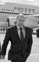 Russian President Vladimir Putin walks past his plane upon his arrival at the airport in Samara, Russia, on Monday.