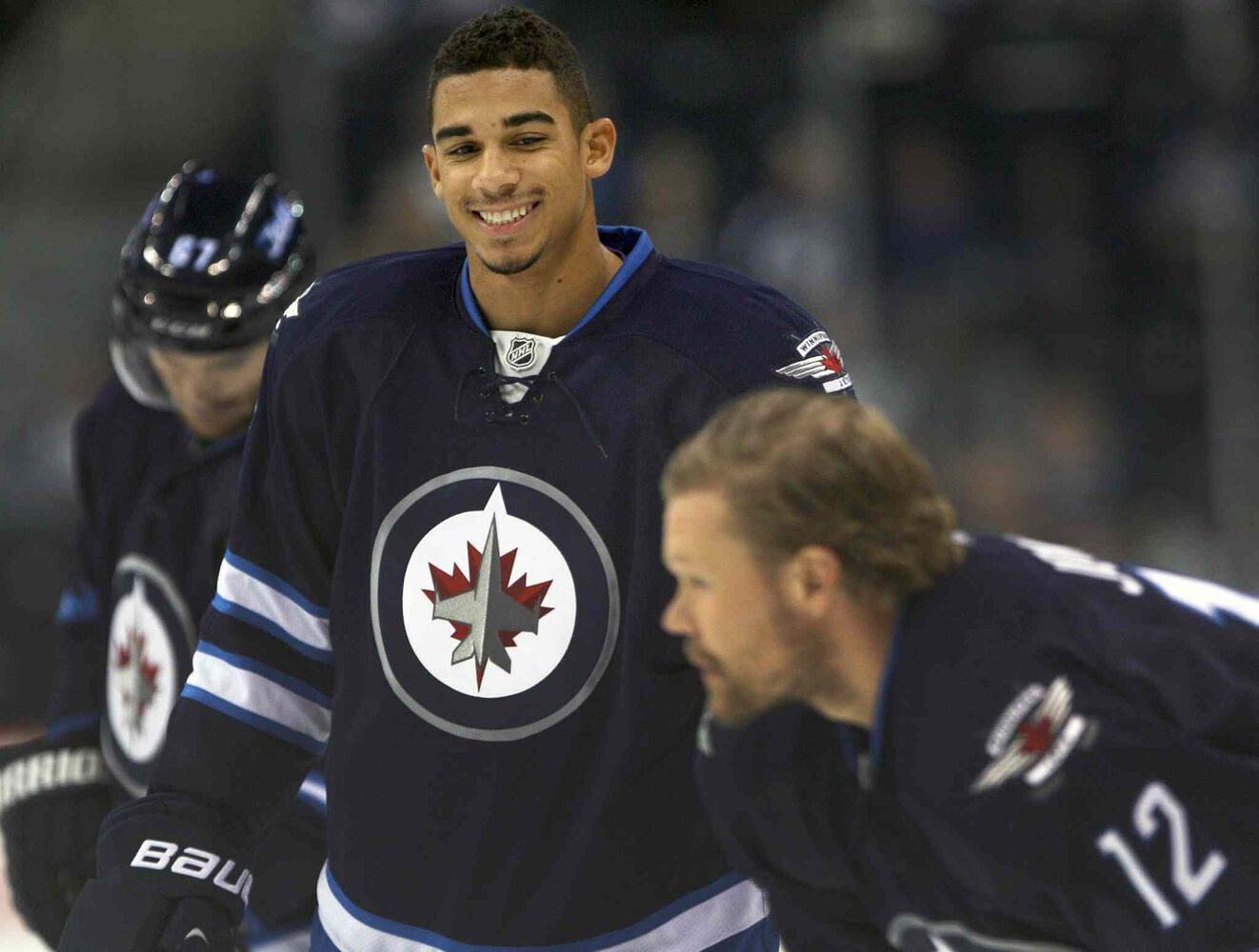 Winnipeg Jets winger Evander Kane (centre) smiles with teammates Michael Frolik (left) and Olli Jokinen during the pre-game skate prior to Friday's game against the Dallas Stars. (JOE BRYKSA / WINNIPEG FREE PRESS)