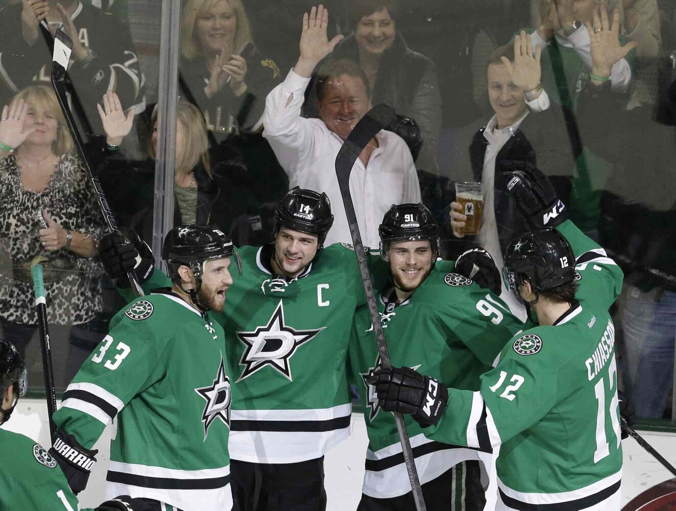 Dallas Stars centre Tyler Seguin (91) celebrates scoring a goal with teammates Alex Goligoski (left), captain Jamie Benn and Alex Chiasson (right) in the second period. (L.M. OTERO / THE ASSOCIATED PRESS)
