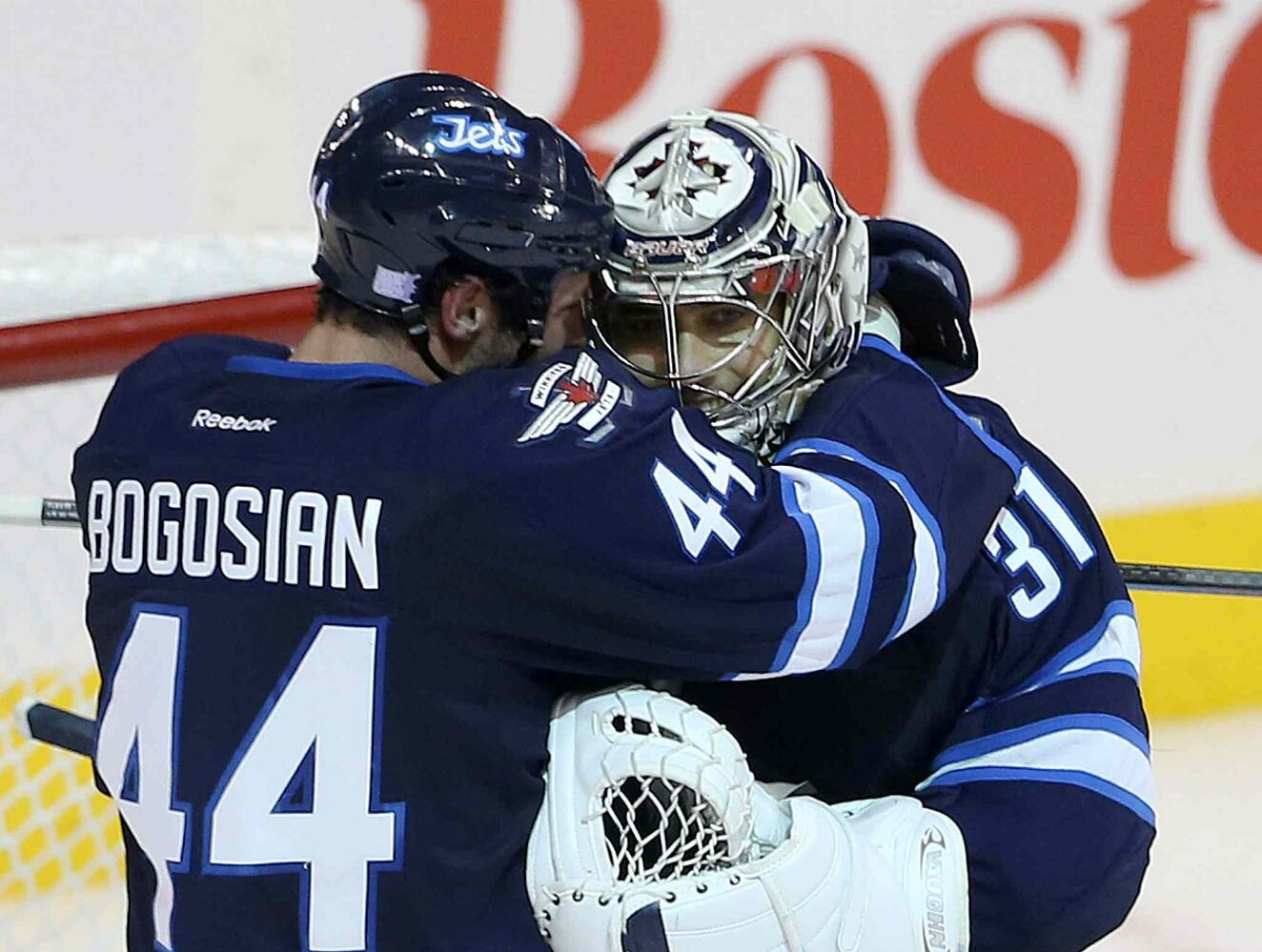 Zach Bogosian (left) celebrates with Ondrej Pavelec after the shootout. (TREVOR HAGAN / WINNIPEG FREE PRESS)