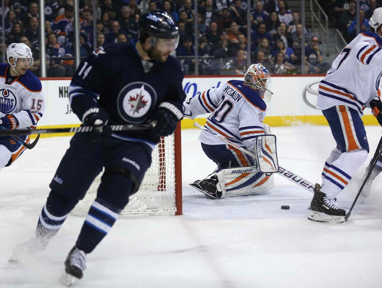 Winnipeg Jets' Anthony Peluso (14) had a shot stopped by Edmonton Oilers' goaltender Ilya Bryzgalov (80) in the second period of Saturday's NHL game at Winnipeg's MTS Centre. (Trevor Hagan / Winnipeg Free Press)