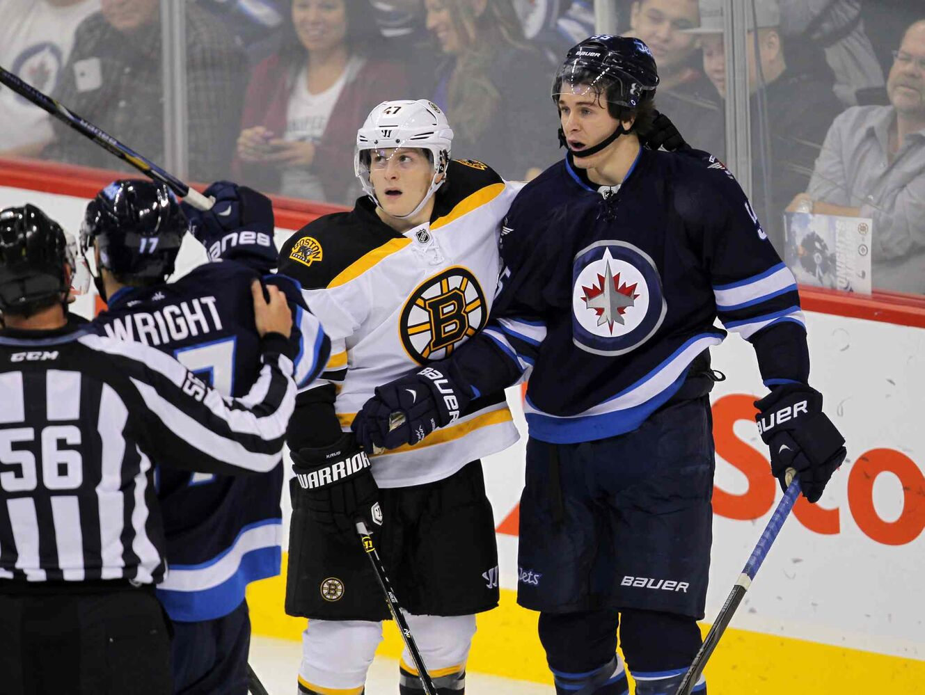 Mark Scheifele and Torey Krug get tangled up.