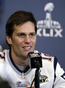 New England Patriots quarterback Tom Brady answers a question during a news conference Wednesday, Jan. 28, 2015, in Chandler, Ariz. The Patriots play the Seattle Seahawks in NFL football Super Bowl XLIX Sunday, Feb. 1, in Phoenix. (AP Photo/Mark Humphrey)