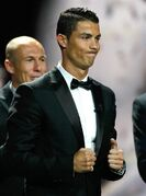 Real Madrid Portuguese forward Cristiano Ronaldo, reacts after winning the best player of the year trophy during the UEFA Champions League draw, at the Grimaldi Forum, in Monaco, Thursday, Aug. 28, 2014.(AP Photo/Claude Paris)