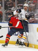 Buffalo Sabres forward Marcus Foligno (82) is checked behind the net by Florida Panthers defenseman Steve Kampfer (3) during the first period of an NHL hockey game, Saturday, Feb. 28, 2015, in Sunrise, Fla. (AP Photo/Joel Auerbach)
