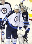 Winnipeg Jets goaltender Ondrej Pavelec celebrates with teammate Evander Kane after the Jets defeated the New Jersey Devils 3-1in Newark, N.J., Monday.