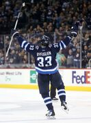 Winnipeg Jets forward Dustin Byfuglien celebrates his second-period goal against the Dallas Stars at the MTS Centre Sunday, March 16, 2014. Byfuglien scored another in the third period as the Jets blasted the Stars 7-2.
