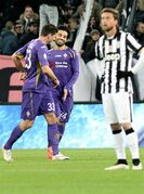 Fiorentina's Mohamed Salah, center, celebrates after scoring during an Italian Cup semifinal first leg soccer match between Juventus and Fiorentina, at the Juventus stadium in Turin, Italy, Thursday, March 5, 2015. (AP Photo/Massimo Pinca)