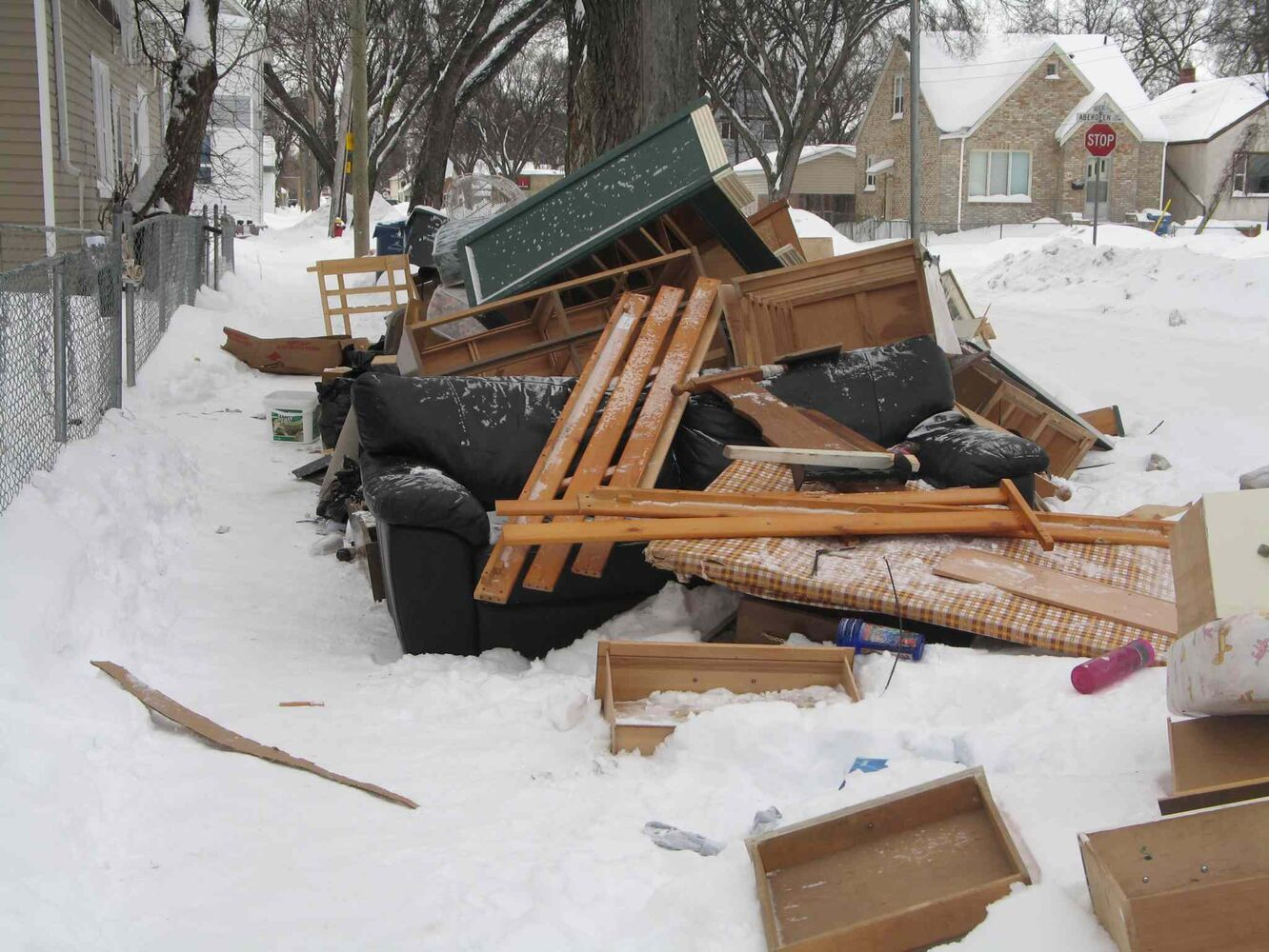 A pile of furniture and garbage on the sidewalk of Andrews Street, near Aberdeen Avenue. COPP documented the situation, with the intention of calling it into 311 upon returning to the William Whyte Residents Assocation office. (Jared Story)