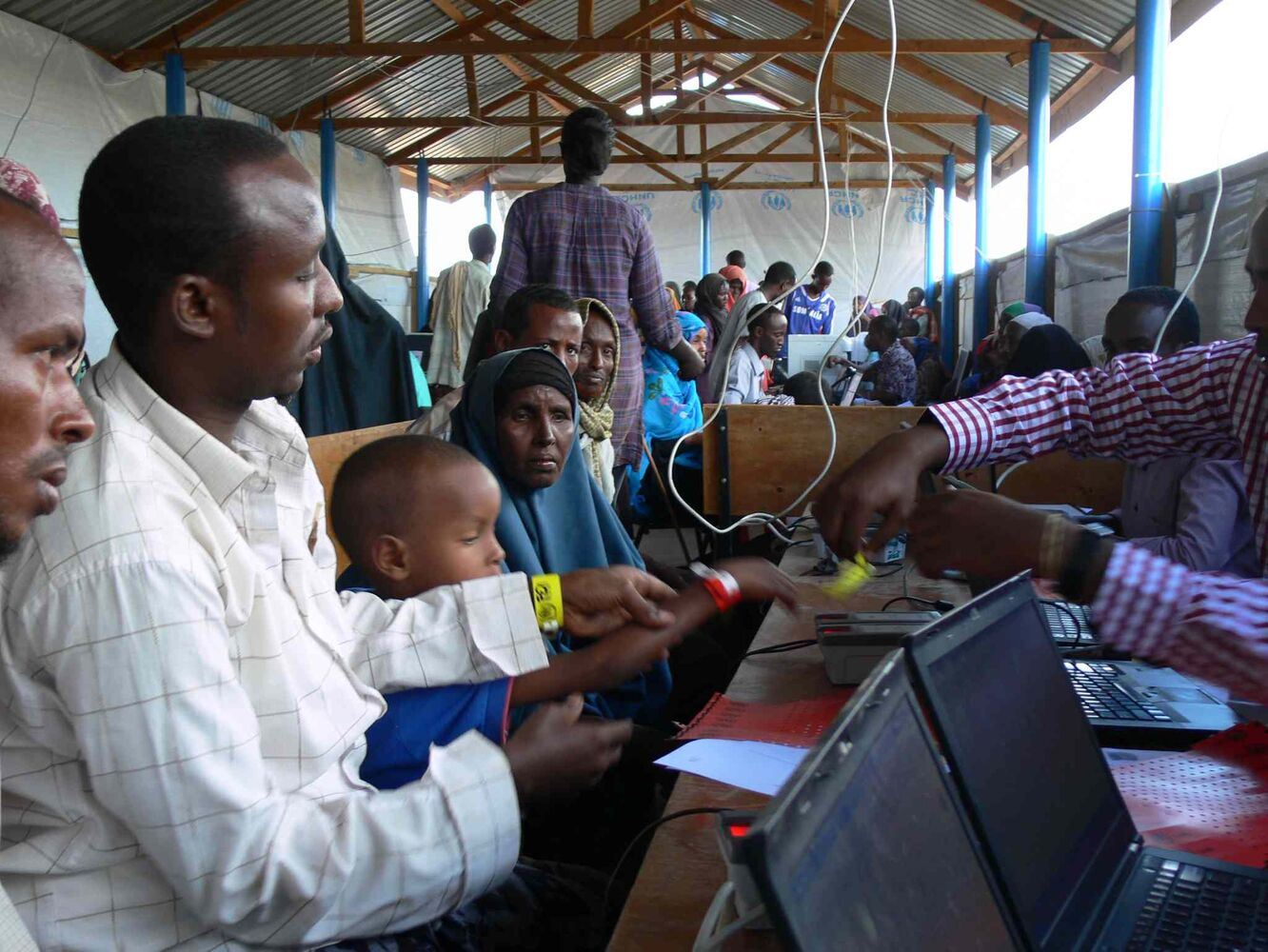 The UNHCR uses biometric imaging to register new refugees at Ifo 2 camp in Dadaab. The electronic system ensures the identity of the refugees, and has seen the number of refugees receiving services in Dadaab reduced from more than 400,000 to just over 357,000. (Carol Sanders / Winnipeg Free Press)