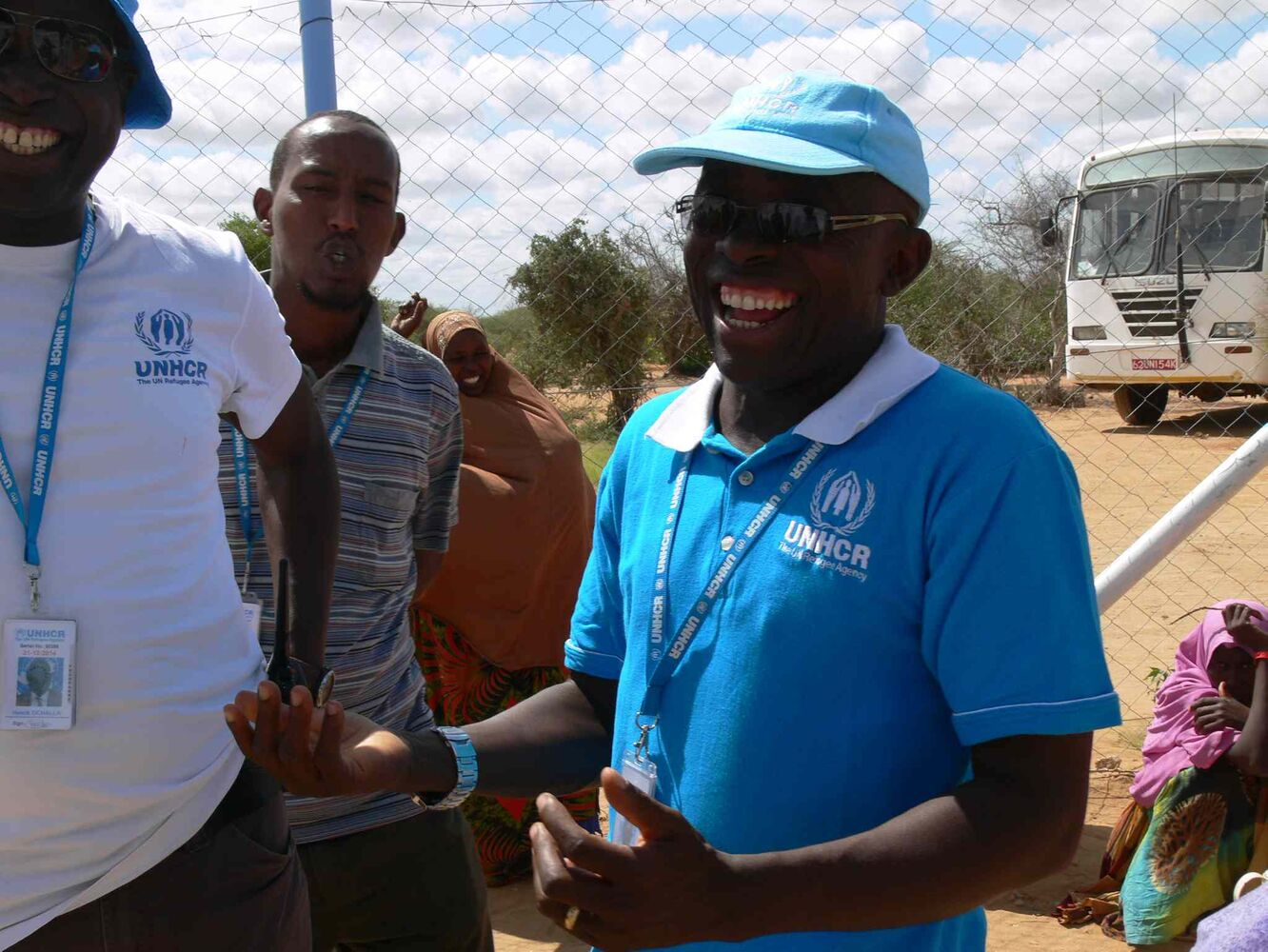 UNHCR staff at the registration centre at Ifo 2 refugee camp in Dadaab. The staff are smiling because refugees who've lived at the camp for months are finally being registered after the Kenyan government lifted the ban on new refugee registrations. (Carol Sanders / Winnipeg Free Press)