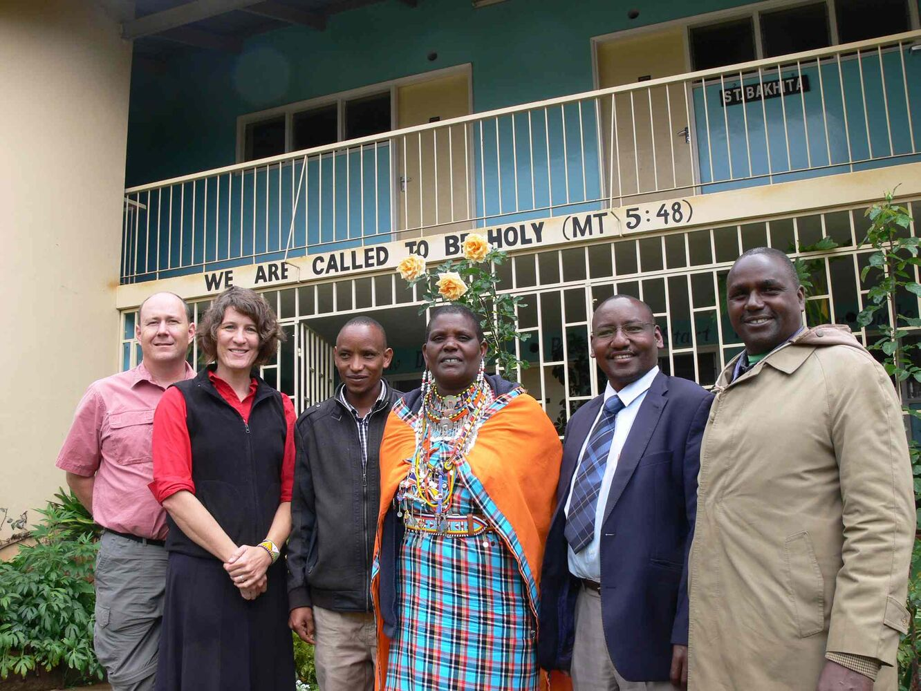 Mennonite Central Committee service workers Doug and Corinna Clymer Olson (left)  meet with members of the Maasai Integrated Development Initiative board: Dennis, Agnes, Moses and Stephen in Ngong outside Nairobi.