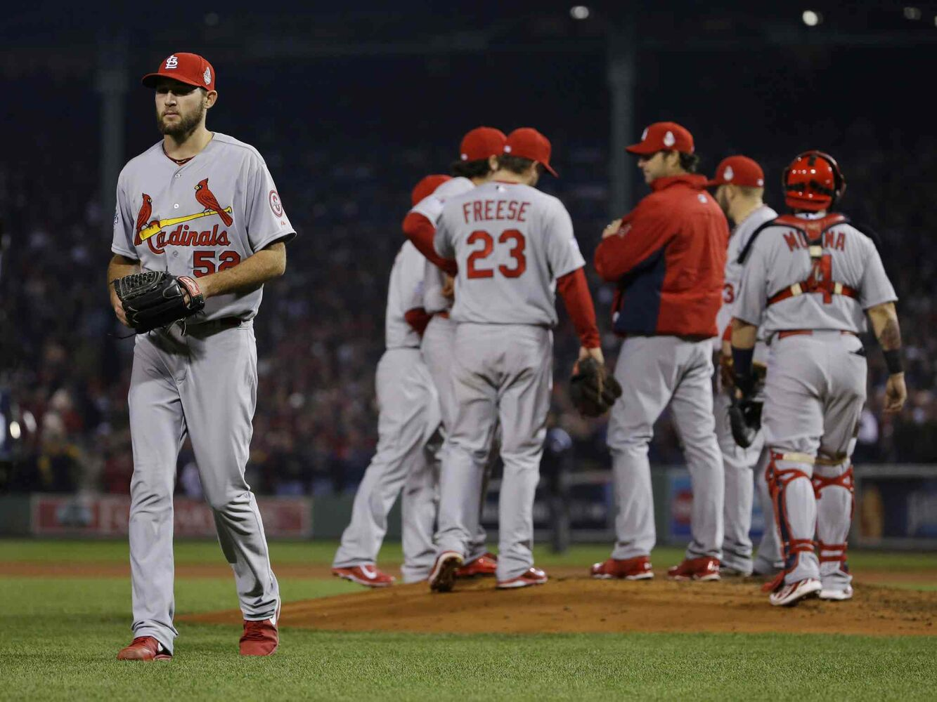 St. Louis Cardinals starting pitcher Michael Wacha walks off the field after being taken out of the game during the fourth inning.