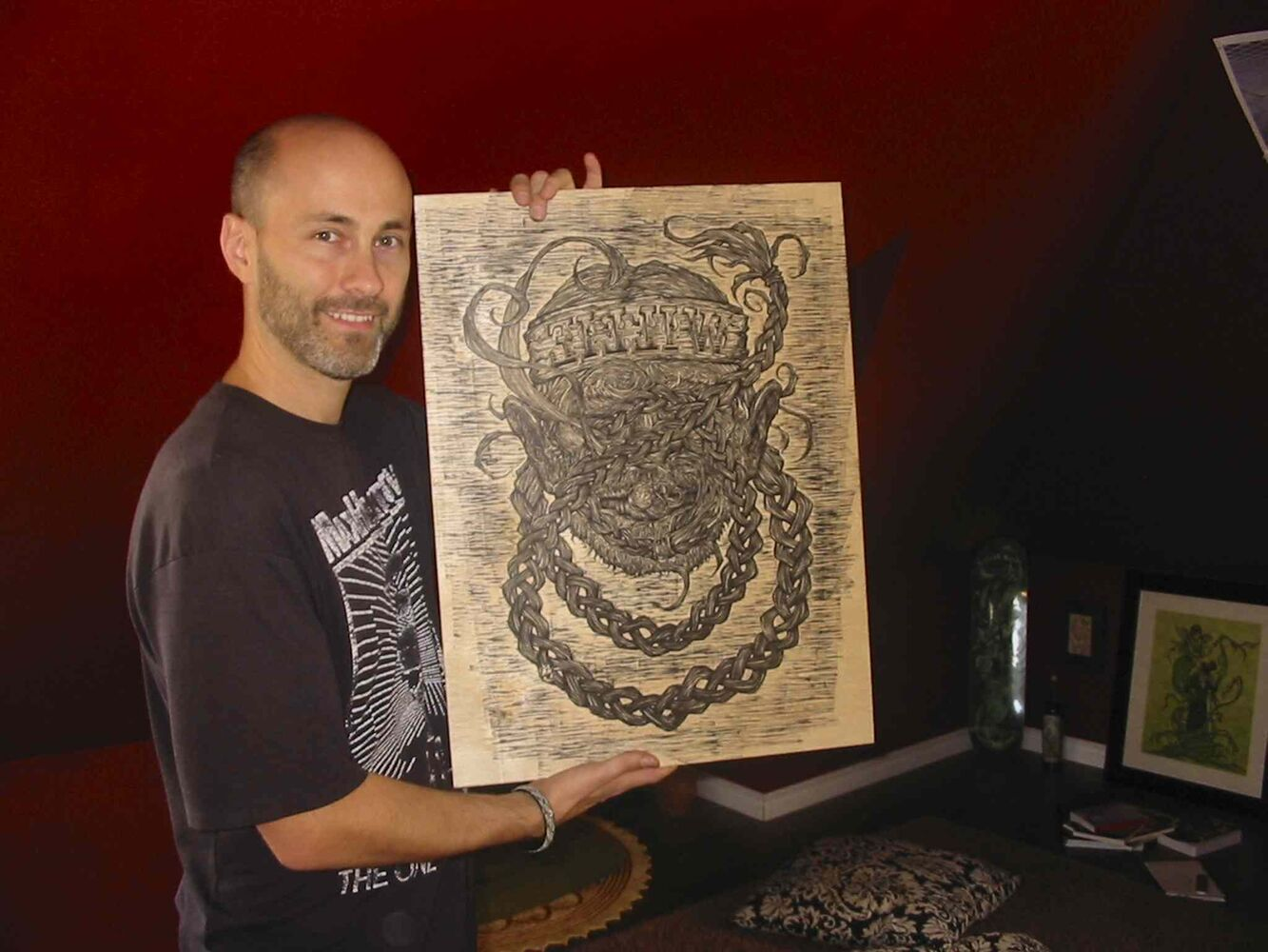 Darcy J. Watt with a woodcut for making prints of Willie Nelson for the music legend's 80th birthday.