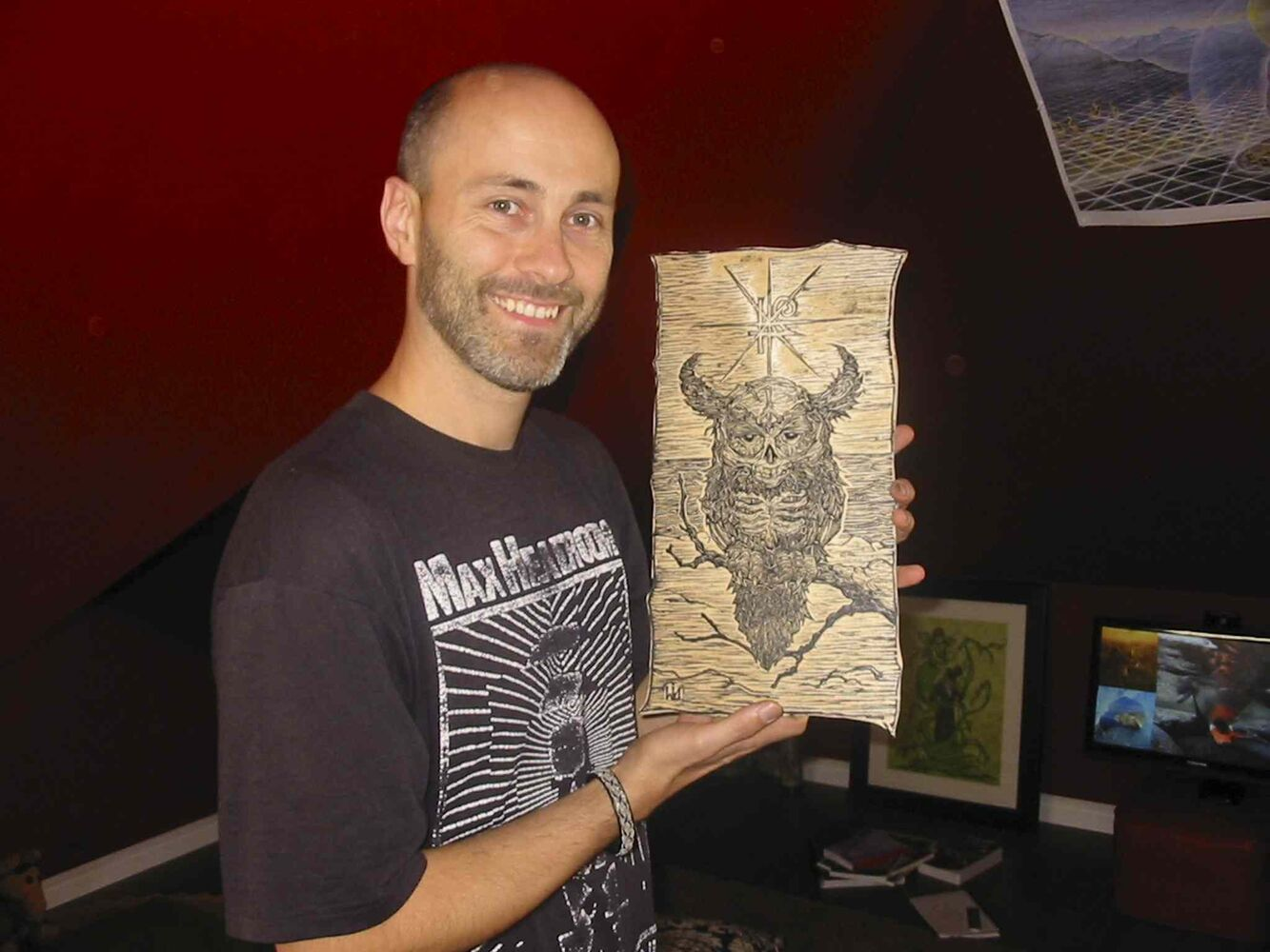 Darcy J. Watt with a woodcut of a mythic creature.