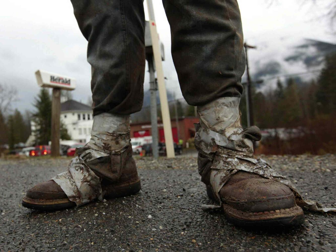 Sonny Blankenship, 18, a senior at Westin High School in Arlington, Wash., walks home from the Oso Fire Department after spending the day volunteering in the mudslide area in Oso, Wash. Blankenship, who lives across the street from the Oso Fire Department, took the day off from school to sort through debris in the slide area just miles from his home.  (Mark Mulligan / The Associated Press / The Herald)