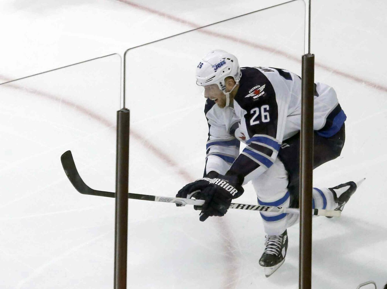 Blake Wheeler celebrates one of his two third-period goals. (Charles Rex Arbogast / The Associated Press)