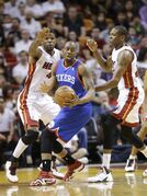 Philadelphia 76ers guard James Anderson, center, looks for an open teammate past Miami Heat forward Udonis Haslem, left, and forward James Jones during the first half of an NBA basketball game on Wednesday, April 16, 2014, in Miami. (AP Photo/Wilfredo Lee)