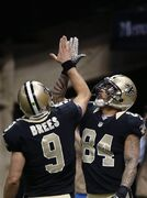 New Orleans Saints wide receiver Kenny Stills (84) celebrates his touchdown reception with quarterback Drew Brees (9) in the second half of an NFL football game in New Orleans, Sunday, Nov. 16, 2014. (AP Photo/Bill Haber)