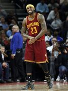 Cleveland Cavaliers forward LeBron James (23) grabs his wrist against the Detroit Pistons in the second half of an NBA basketball game in Auburn Hills, Mich., Tuesday, Jan. 27, 2015. (AP Photo/Paul Sancya)