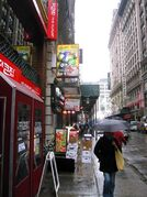 This March 25, 2015 photo shows West 32nd Street in Manhattan, also known as Korea Way or Koreatown. The enclave is home to numerous Asian businesses, including Korean restaurants and karaoke bars. (AP Photo/Beth J. Harpaz)