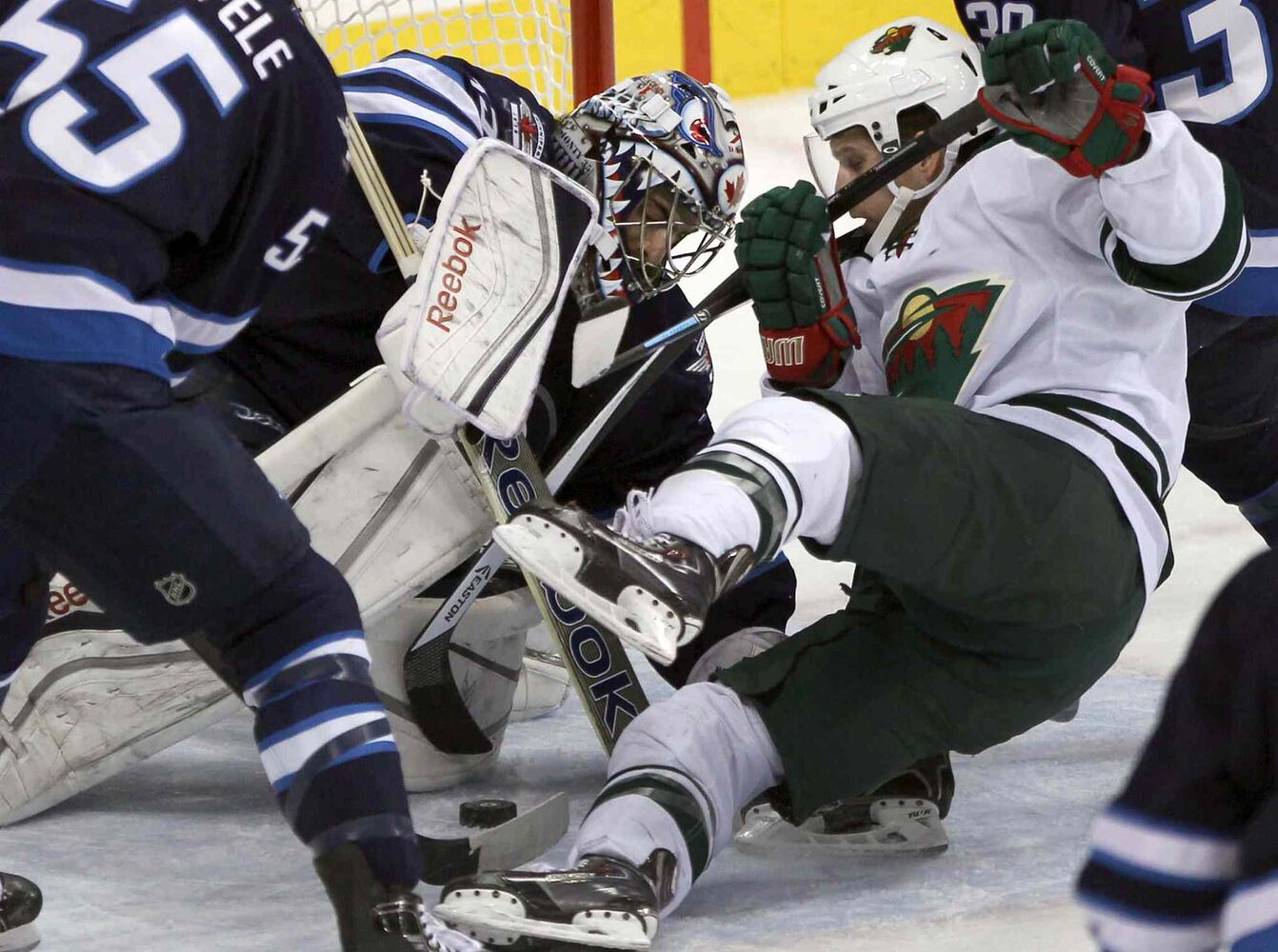 Winnipeg Jets goaltender Al Montoya is challenged by Justin Fontaine of the Minnesota Wild during the first period. (JOE BRYKSA / WINNIPEG FREE PRESS)