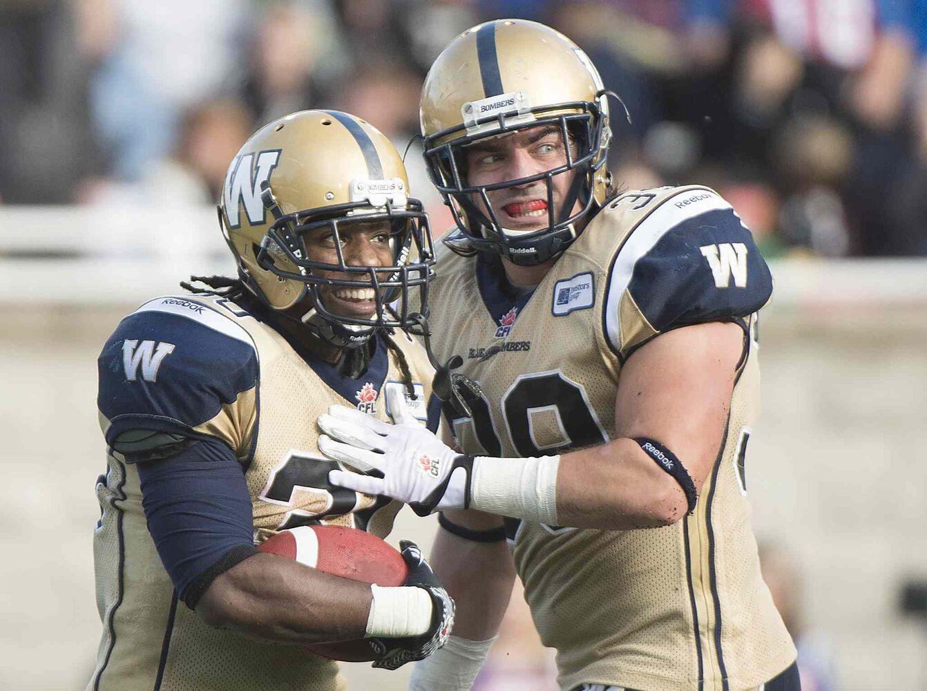 Winnipeg Blue Bombers' Will Ford, left, celebrates with teammate Michel-Pierre Pontbriand after scoring a touchdown against the Montreal Alouettes during second-half CFL football action in Montreal Monday. The Bombers went on to win 34-27.