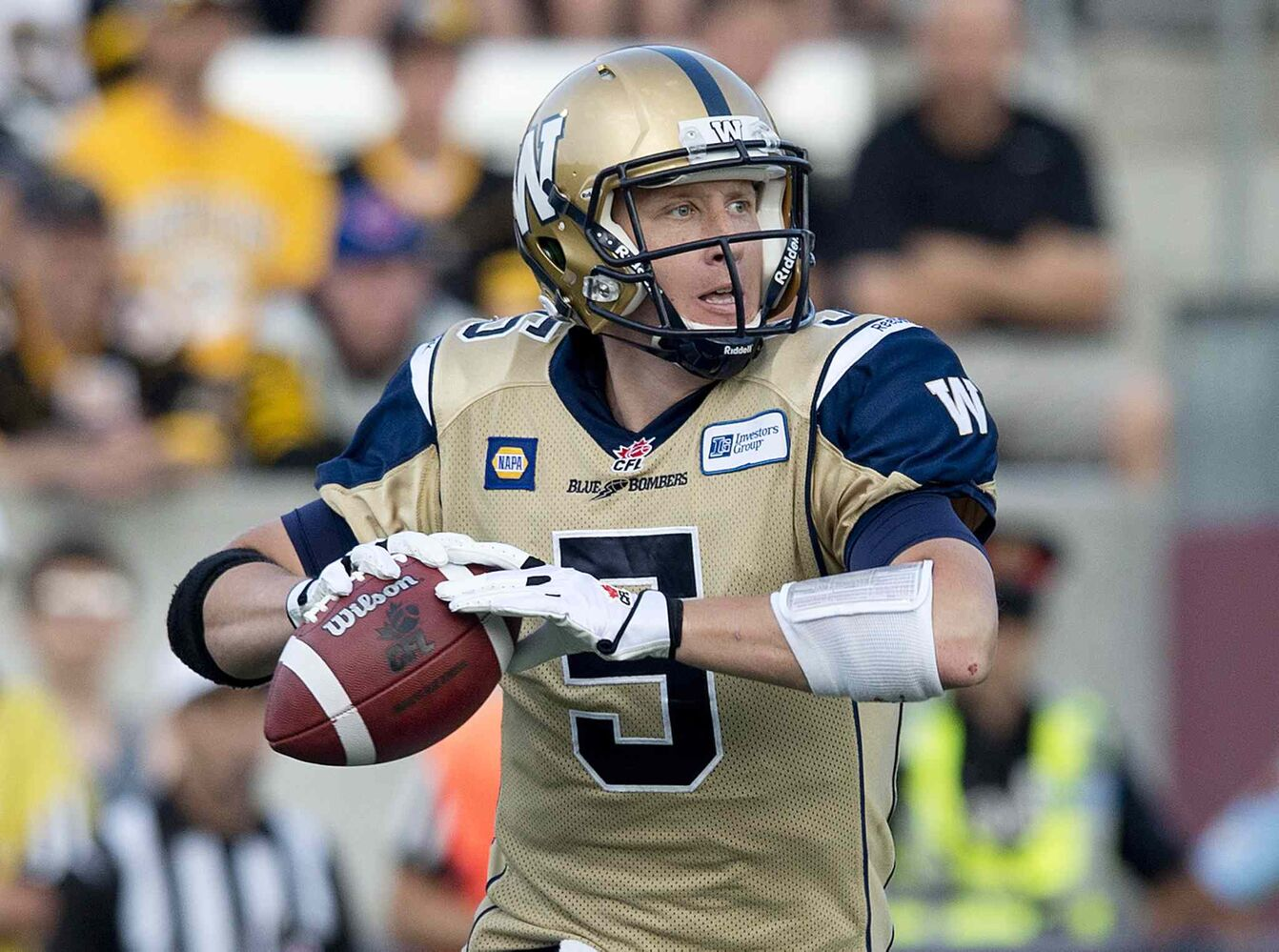 Winnipeg Blue Bombers' quarterback Drew Willy looks for a pass against the Hamilton Tiger-Cats in the first half of Thursday's game. (Nathan Denette / The Canadian Press)
