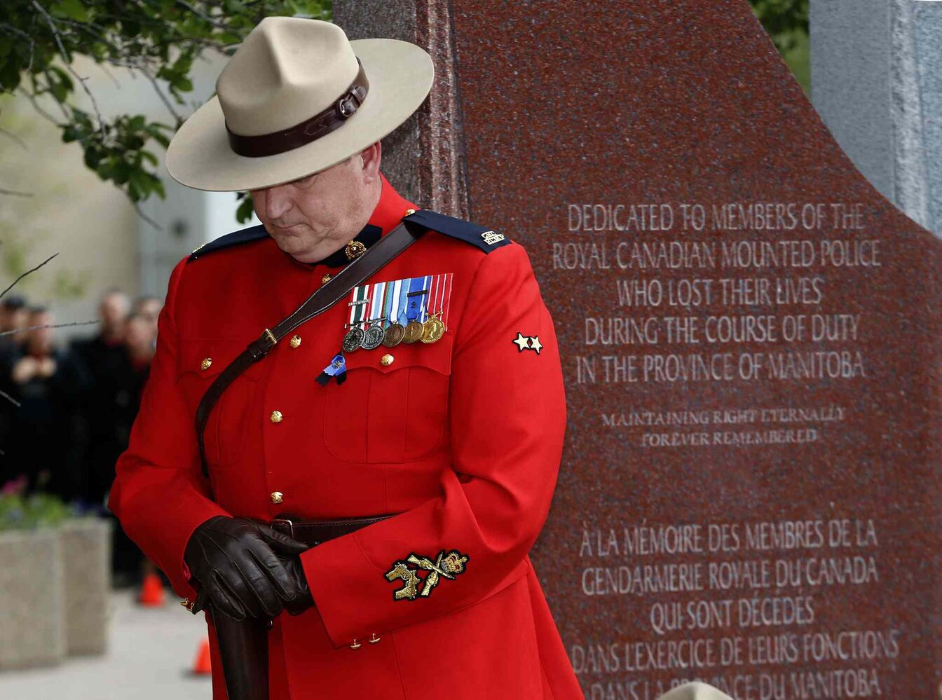 Const. Bruce Mellor, one of two honourary sentries, participates in a wreath-laying ceremony in Winnipeg on Tuesday.  (KEN GIGLIOTTI / WINNIPEG FREE PRESS)