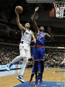 Dallas Mavericks forward Chandler Parsons (25) goes up to shoot as New York Knicks' Samuel Dalembert (11), of Haiti, defends in the first half of an NBA basketball game, Wednesday, Nov. 26, 2014, in Dallas. (AP Photo/Tony Gutierrez)