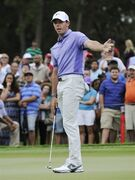 Rory McIlroy, of Northern Ireland, reacts after missing a putt for birdie on the eighth hole during the final round of rhe Tour Championship golf tournament Sunday, Sept. 14, 2014, in Atlanta. (AP Photo/John Amis)