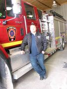 Fire chief Jamie Vanderhorst stands next to one of the St. Francois Xavier volunteer fire department's vehicles.