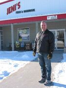 Tom Bell, owner of Jeni's Food and Hardware in La Salle, is eager for new residents to move to the community.