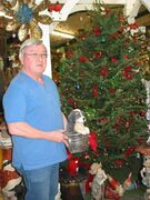 Kevin Twomey shows one of the many gift items available at T & T Seeds at 7724 Roblin Blvd. in the RM of Headingley.