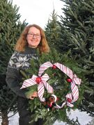 Verna McGuckin holds one of many fresh wreaths created at the business she runs with her husband. Roy, in Headingley.