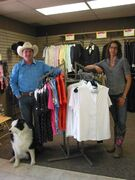 Westgates Horse & Country owner Lee Myers (left) and staff member Amanda Klassen, with Myers' dog Jaxon, display some of the equestrian clothing the store at 5421 Portage Ave. in Headingley carries.