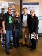 Dennis and Marleen Bell (co-ordinators of We Rock Manitoba), Craig Kielburger founder of Free The Children), and Christine Strutt (co-ordinator of We Rock Manitoba) are shown.