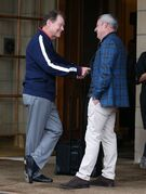 US Ryder Cup captain Tom Watson, left, speaks with European Ryder Cup captain Paul McGinley as he leaves The Gleneagles Hotel, Gleneagles Scotland Monday Sept. 29, 2014. The European tyeam retained the Ryder Cup beating the U.S. team 16 1/2-11 1/2. (AP Photo/Andrew Milligan/PA) UNITED KINGDOM OUT NO SALES NO ARCHIVE