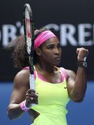 Serena Williams of the U.S. celebrates a point won against Garbine Muguruza of Spain during their fourth round match at the Australian Open tennis championship in Melbourne, Australia, Monday, Jan. 26, 2015. (AP Photo/Rob Griffith)