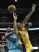 Los Angeles Lakers' Wesley Johnson (11) is fouled by Charlotte Hornets' Marvin Williams (2) during the first half of an NBA basketball game in Charlotte, N.C., Tuesday, March 3, 2015. (AP Photo/Chuck Burton)