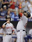 Boston Red Sox's David Ortiz, right, and Dustin Pedroia react after Ortiz hit a three-run home run off Tampa Bay Rays starting pitcher Chris Archer during the third inning of a baseball game Sunday, July 27, 2014, in St. Petersburg, Fla. Red Sox's Pedroia and Daniel Nava also scored on the hit. (AP Photo/Chris O'Meara)